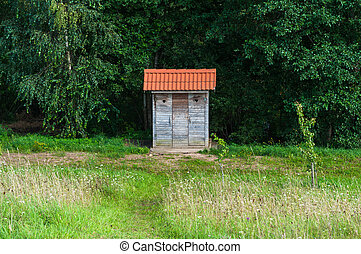 Outhouse in a meadow