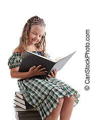 Little girl with pigtails reading a book