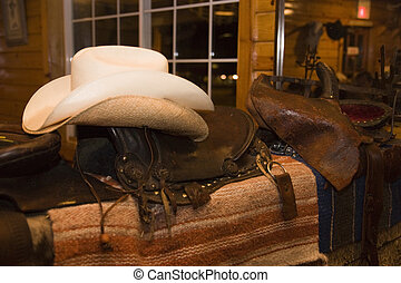 Cowboy equipment in a west usa saloon