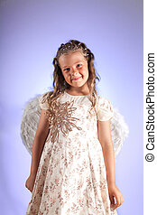 Cute little girl with pigtail hairstyle and angel wings