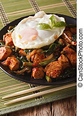 Thai cuisine: Stir-Fry Gai Pad Krapow chicken on a plate...