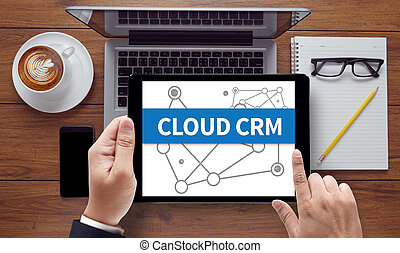 CLOUD CRM, on the tablet pc screen held by businessman hands...