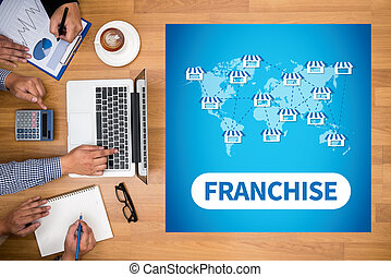FRANCHISE Business team hands at work with financial reports...