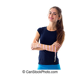 Woman holding centimeter around her arm - Young smiling...