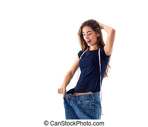 Woman wearing jeans of much bigger size - Young happy woman...