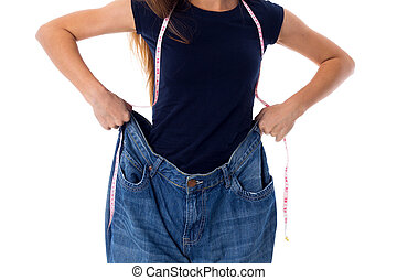 Woman wearing jeans of much bigger size - Young woman in...