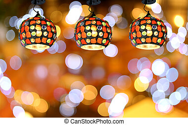 Warm lighting modern ceiling lamps in the cafe. - Warm...