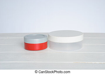 tib of face cream with red cover - tub with a face cream...