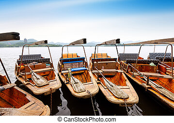 West Lake in Hangzhou, China - Traditional wooden row boat...
