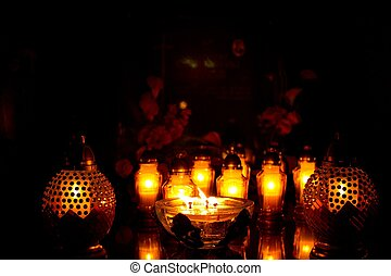 glowing candles on the grave 2 - glowing candles on the...