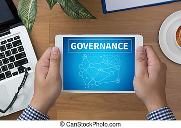 GOVERNANCE man hand Tablet and coffee cup