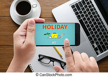 HOLIDAY HOMEPAGE message on hand holding to touch a phone,...