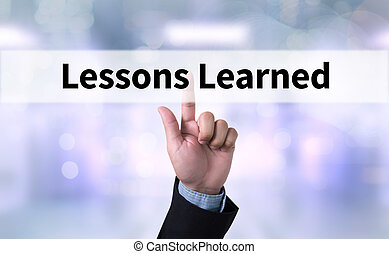 Lessons Learned Business man with hand pressing a button on...