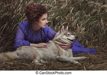 Woman with dog watching closely.