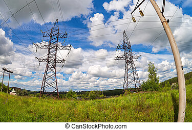 Summer landscape with electric power lines on a blue sky background