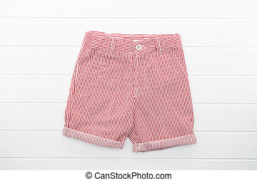 Short pants and clothes on white wooden background