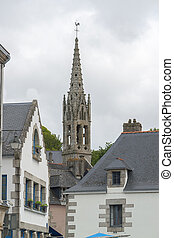 steeple at Pont-Aven in Brittany - church steeple and house...