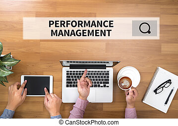 PERFORMANCE MANAGEMENT Two Businessman working at office...