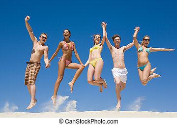 Joyful teens - Joyful team of friends holding for hands each...