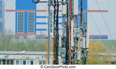 closeup of the towers with telecommunications equipment on...