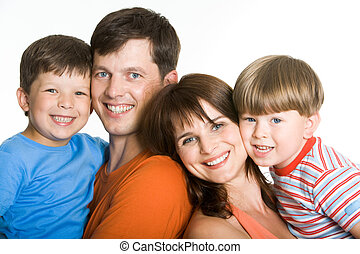 Together - Portrait of joyful parents holding their sons and...