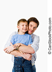 Hug - Portrait of father hugging her son with happy smile