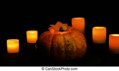 Helloween pumpkin rotation and candles dolly shot