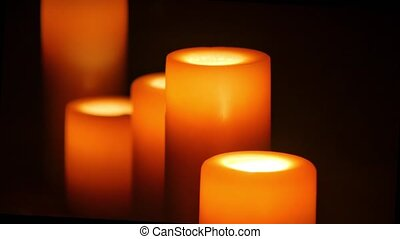 Five big candles in darkness close up shot - big candles in...