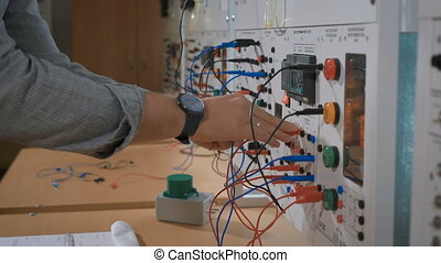 Male technician change parameters of laboratory experiment -...