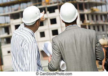 Backs of workers - Photo of backs of workers interacting and...