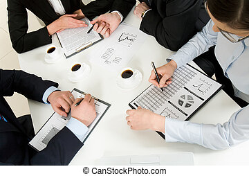 Discussing plan - Above view of successful workteam...
