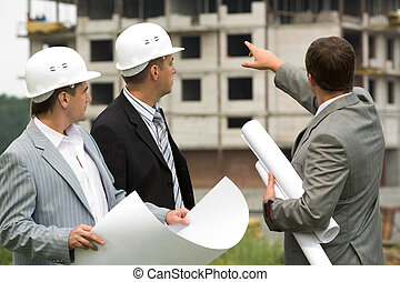 Three workers - Image of three workers looking construction...