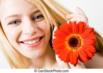 Herbera in hands - Close-up of cheerful young female holding...