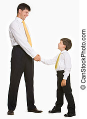 Handshaking - Portrait of father and son standing and...