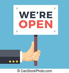 Hand holding we are open banner. Wooden sign, paper placard...