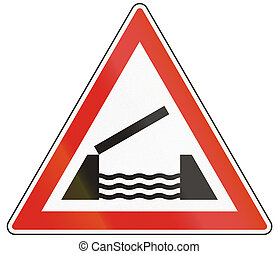 Hungarian warning road sign - Opening or swing bridge ahead.