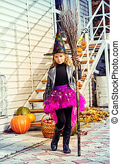 fairy girl - Pretty little girl in a costume of witch with...