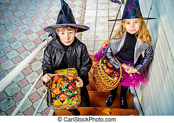 candy trick or treat - Happy children in a costumes of...