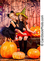 october kids - Two cute little girl in halloween costumes...