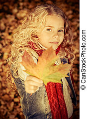 collect herbarium - Cute smiling girl walking on a yellow...