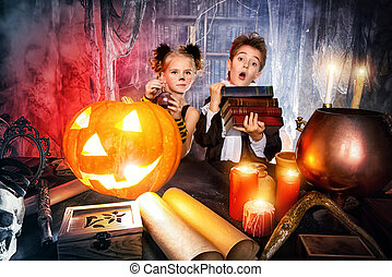 funny kids - Two cute children dressed as a vampire and a...