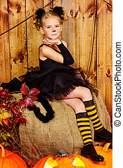 black cat girl - Lovely little girl in a costume of black...