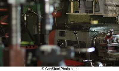 Old drilling machine in workshop - Old vertical drilling...