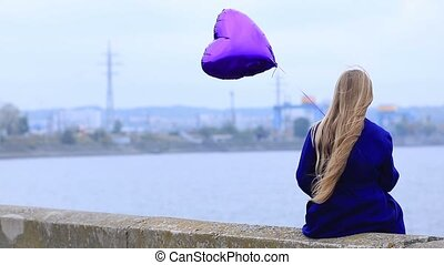 Sad girl holding heart balloon - Sad girl with broken heart...