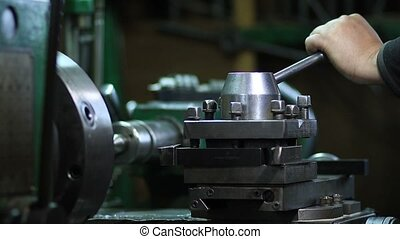 Operator working at lathe machine - Operator preparing to...