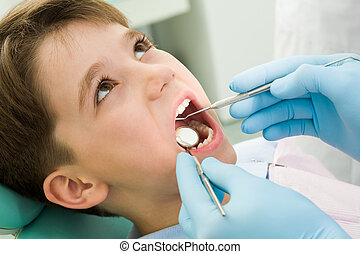 Healing teeth - Close-up of little boy opening his mouth...