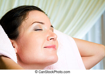 Hair treatment - Face of serene female with her eyes closed...