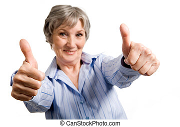 Successful woman - Image of successful aged woman showing...