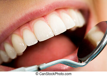Mouth checkup - Close-up of patients open mouth before oral...