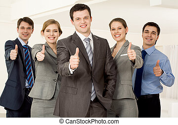 Success - Portrait of happy business partners looking at...